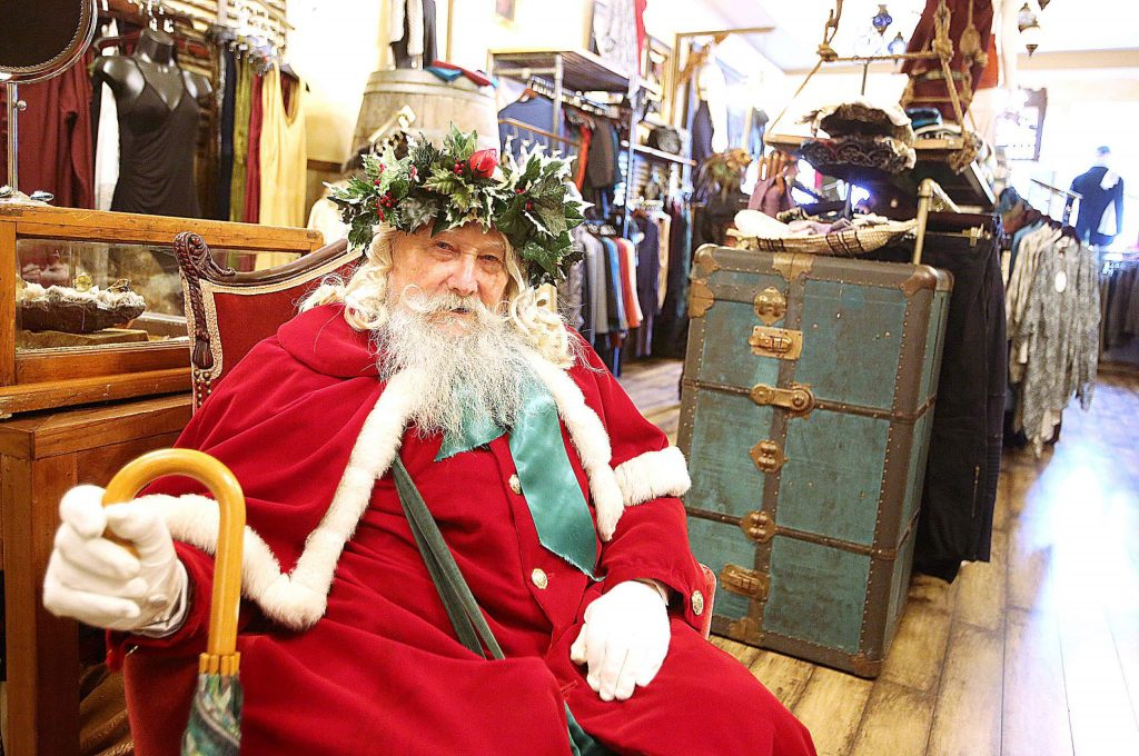 Father Christmas played by Warren Nordendahl takes a break from taking photos with folks inside of The Phoenix Rose on Broad Street during Sunday's Victorian Christmas.
