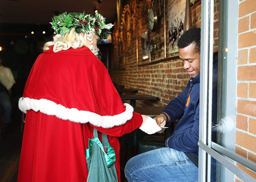 Everyone must have their ID checked when entering McGee's in downtown Nevada City, even Father Christmas.
