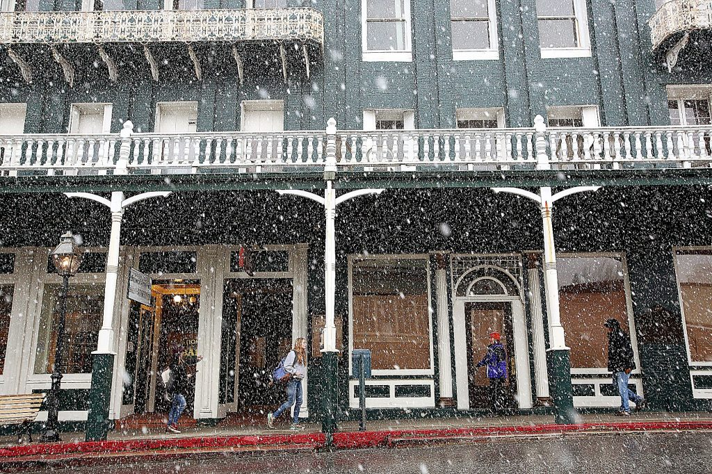 24) Pedestrians walk in front of the historic National Exchange Hotel in Nevada City during snowfall in February.