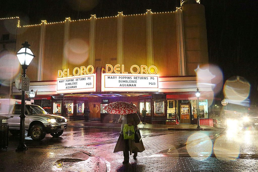 Pedestrians don their umbrellas after leaving the Del Oro Theater in downtown Grass Valley during Tuesday's  rainfall which dropped nearly an inch and a half of rain. A much stronger wave of precipitation will reach Nevada County today causing white out conditions in the Sierra Nevada.