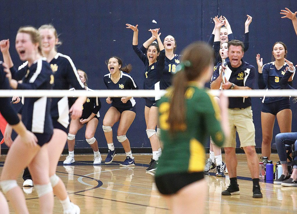 The Nevada Union Miners girls varsity volleyball team celebrates after winning a key point against the Hilmar Yellowjackets en-route to their division championship game.