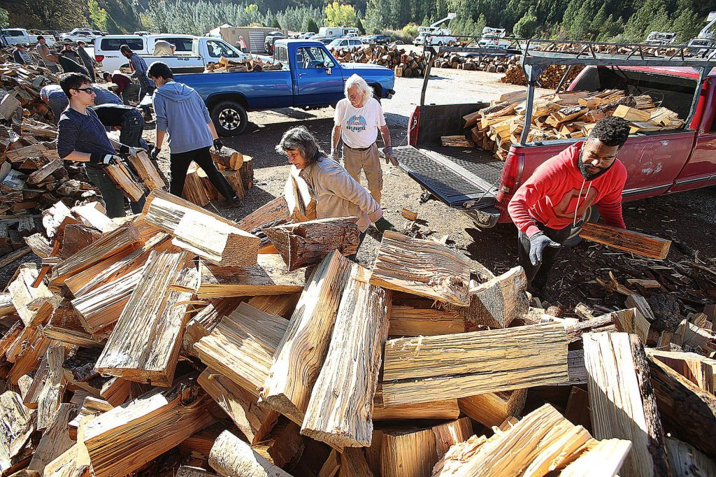 Volunteers for the Gold Country Senior Firewood Program work hand in hand earlier in the month off of Brunswick Road, as volunteers and clients alike helped load up firewood for the final of their three annually scheduled firewood pickup and distribution days.
