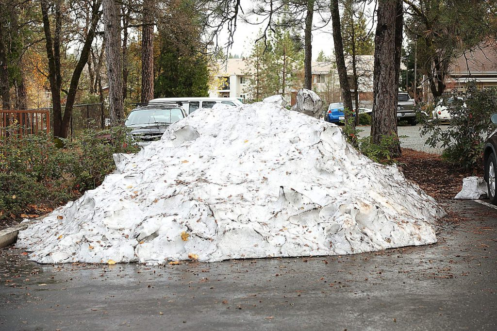 A parking lot iceberg slowly melts in the Glenbrook Plaza shopping center Thursday afternoon a week after a low snow storm covered Nevada County elevations down to 1,500 feet. Snow levels for this weekend's storm will start at 6,500 feet today before dropping to 5,500 feet by Saturday night.