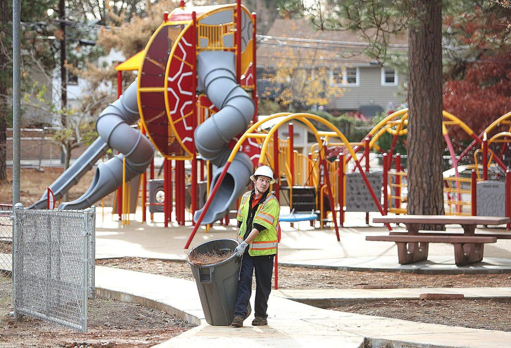 City of Grass Valley parks worker Jesse Love used Thursday's pleasant temperatures and sunny skies to help prepare Minnie Park for landscaping work. New equipment and structures have been installed at Minnie Park, which is scheduled to reopen in January. Rain is in the forecast for today through the weekend with 3 to 4 inches of rain expected by Sunday. Snow levels will start at 6,500 feet on Friday before dropping to 5,500 feet by Saturday night.