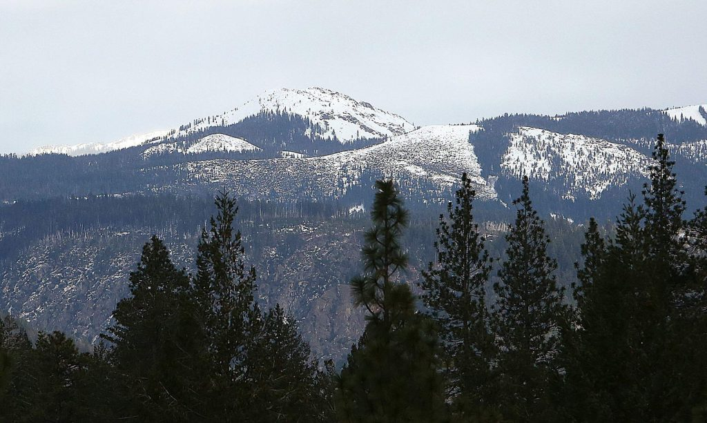 At 7,490 feet, Fall Creek Mountain rises above Nevada County as seen from the Highway 20 overlook, dusted in snow.