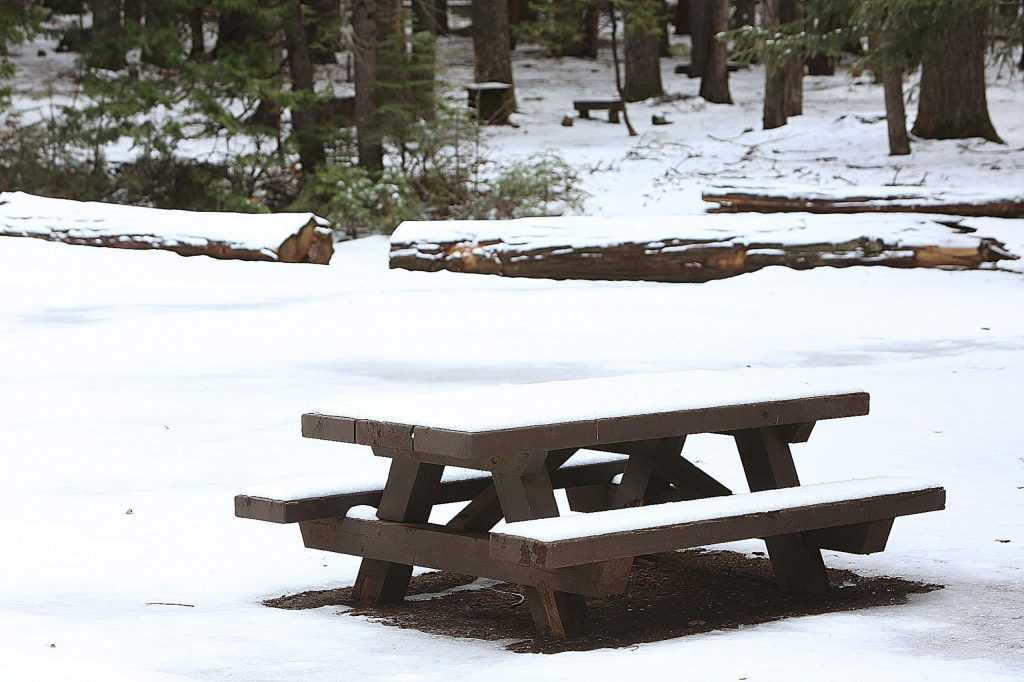 Low snow covers the picnic tables of the Skillman Horse Campground — 14 miles east of Nevada City along Highway 20 — following Wednesday's storm, which brought snowflakes down to 3,000 feet. The campground, closed for the season, is at 3,700 feet. Chances of precipitation will drop to 10% through Saturday, but will increase to a 90% chance of rain Sunday. Low snow may return to Grass Valley and Nevada City on Christmas Eve and Christmas.