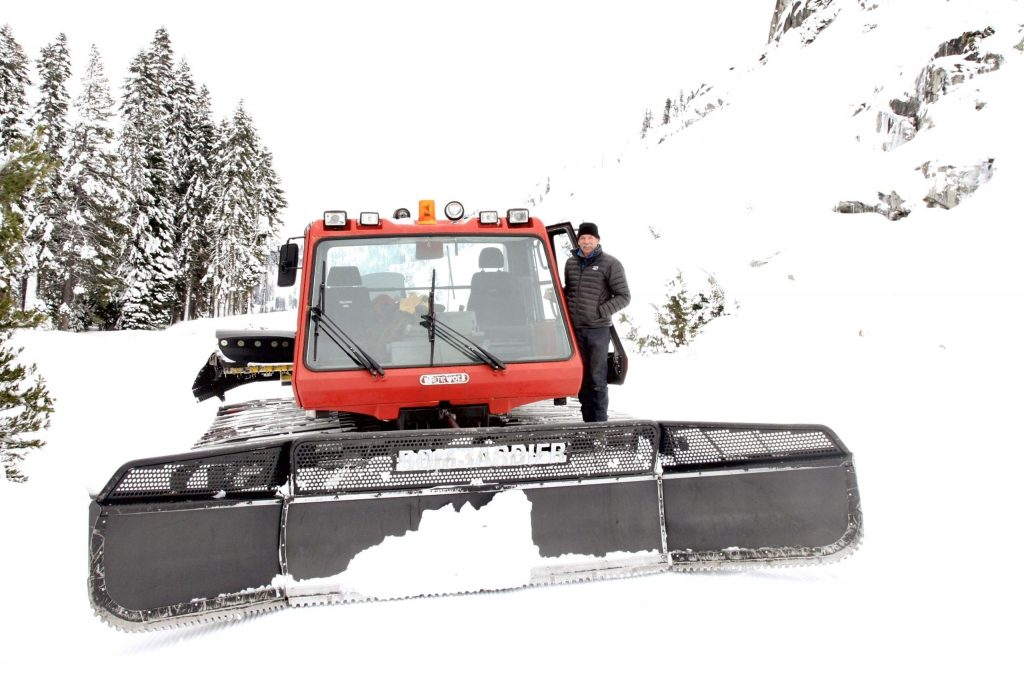 Troy Caldwell stands next to his snow cat that he uses to travel around the property during the winter.