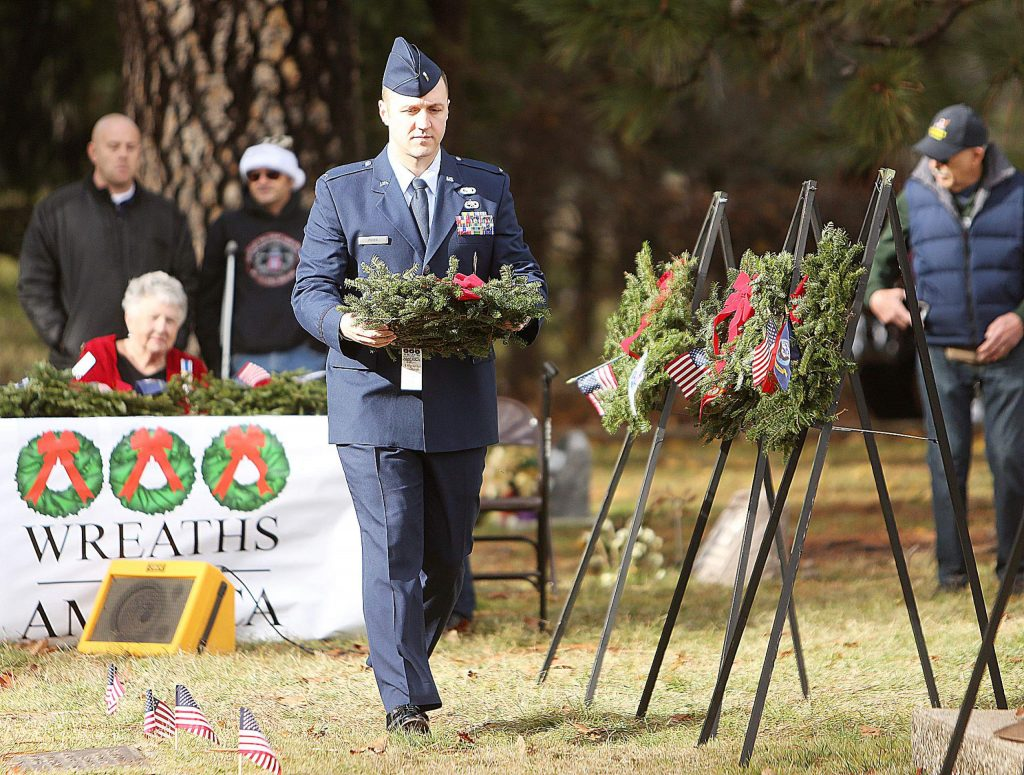 Active duty U.S. Air Force representative Will Prier places a wreath during Saturday's ceremony.