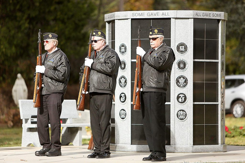 Members of the Nevada County All Veterans Honor Guard stand in front of the new veteran's columbarium during Saturday's Wreaths Across America Ceremony. An official dedication of the columbarium is expected to take place in 2020.