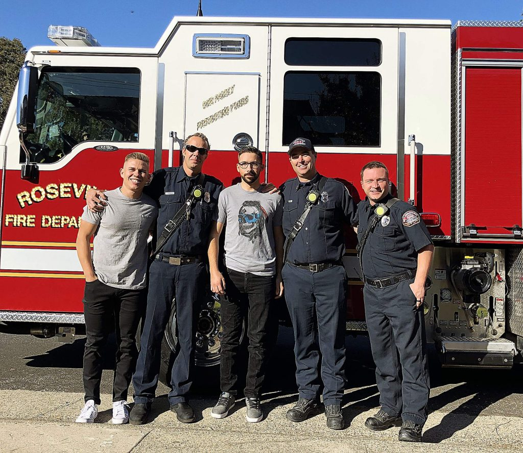 Members of the Roseville Fire Department visited Ryan Yokom after his surgery.