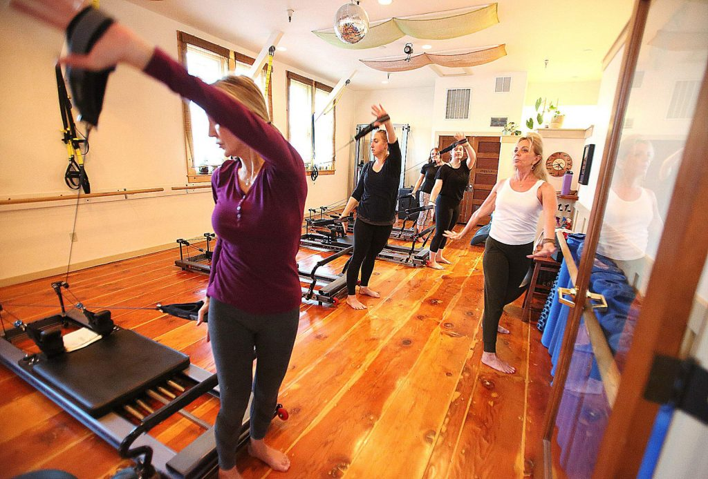 Roxanna Cohen (right) leads a pilates class Wednesday in downtown Grass Valley's The Pilates Place.