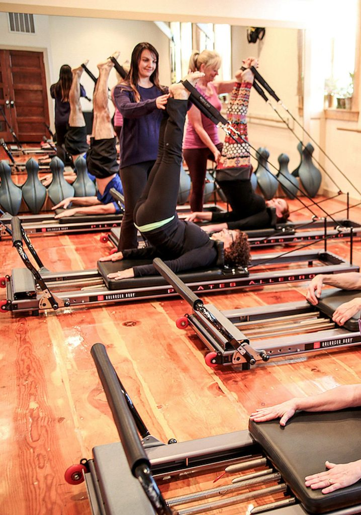 A fitness member gets a workout at The Pilates Place of Grass Valley. Pilates Place owner Roxanna Cohen at first was against AB 5, but recently she's come around to embrace the law.