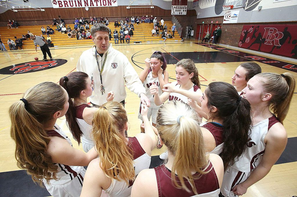 Bear River girls head coach Jeff Bickmore gets his varsity girls team ready for their second half against Placer Tuesday evening.