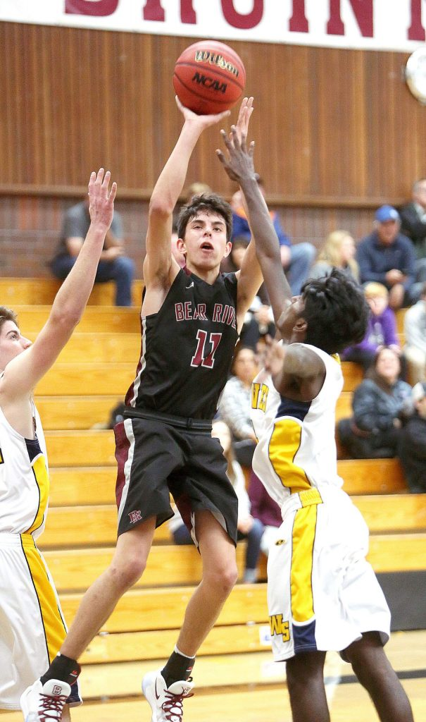Bear River's Caleb Lowry (11) pulls up to make a mid range jump shot during a Ganskie tourney matchup against Western Sierra Collegiate Academy.