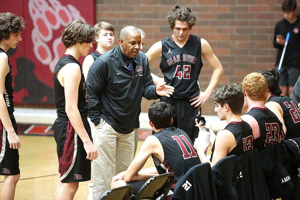 Bear River Bruins head coach Ralph Lewis talks to the team during a timeout at the Ganskie Tournament. Lewis and the Bruins won the Ganskie tourney, and open Kendall Arnett Tournament play tonight at Placer High School,