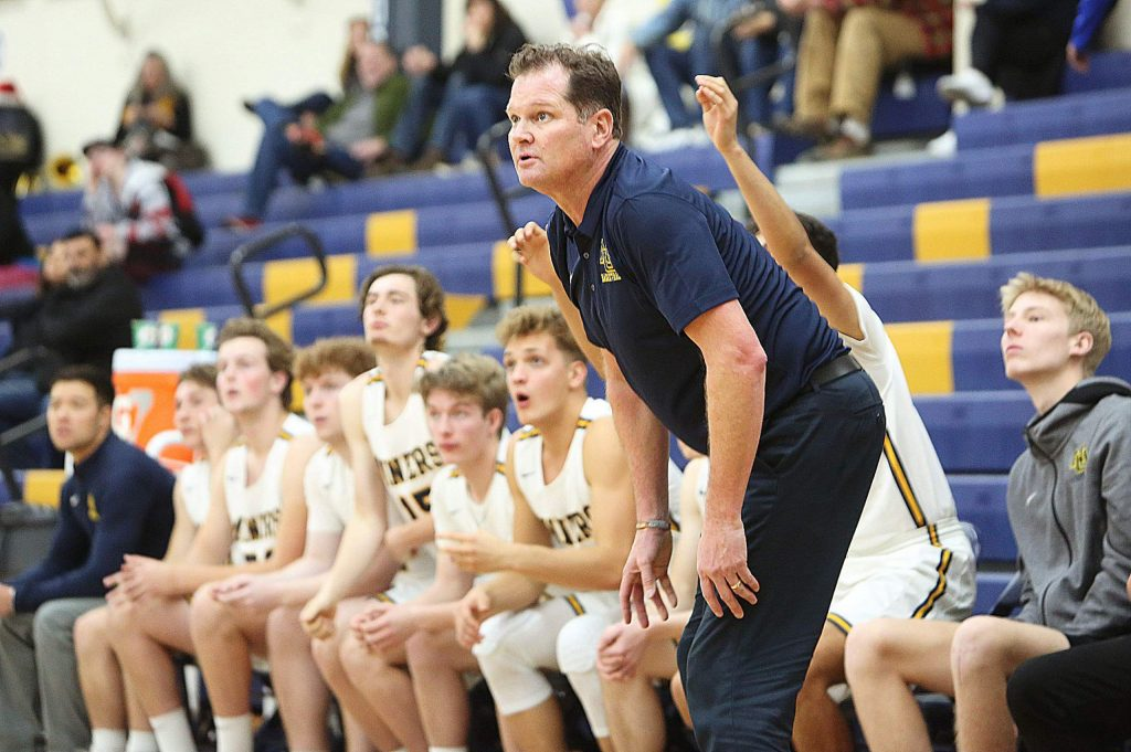Nevada Union head coach Mark Casey watches from the sideline during a game against River Valley in the first round of the Justin Gardner Memorial Tournament at Albert Ali Gymnasium.