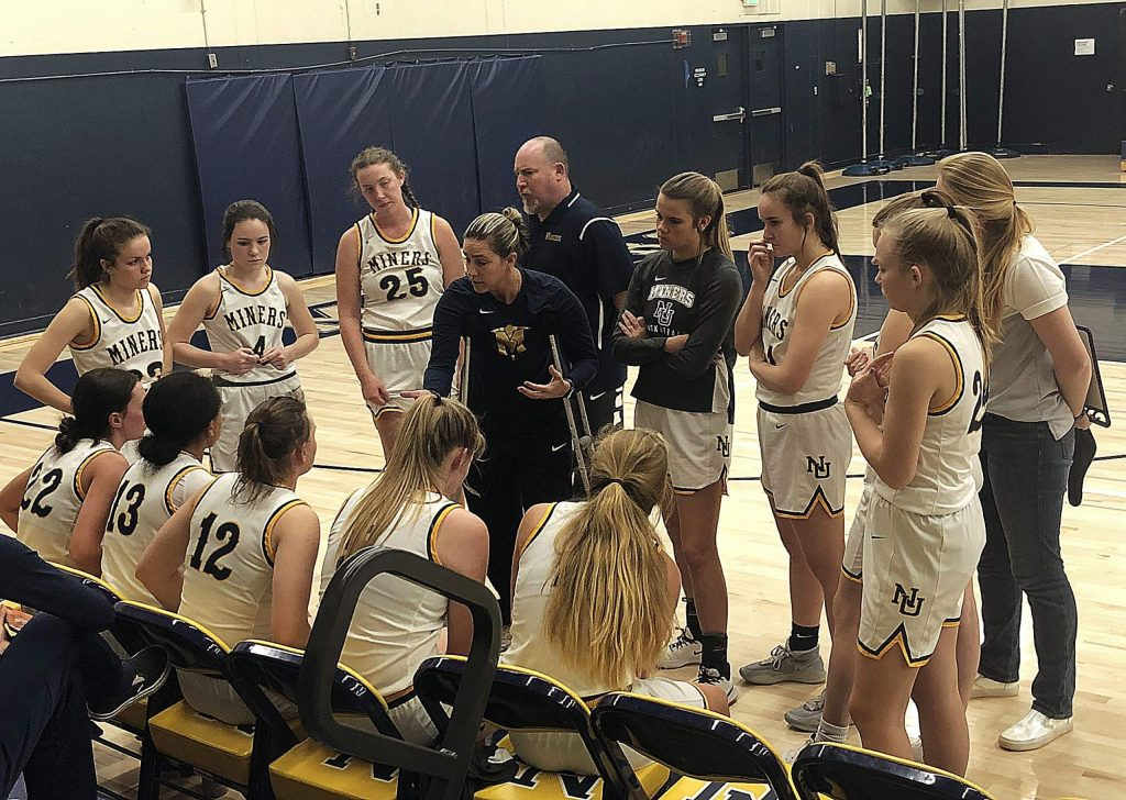 Nevada Union heaed coach Jenn Krill talks with her team during game against Sacramento, Monday.