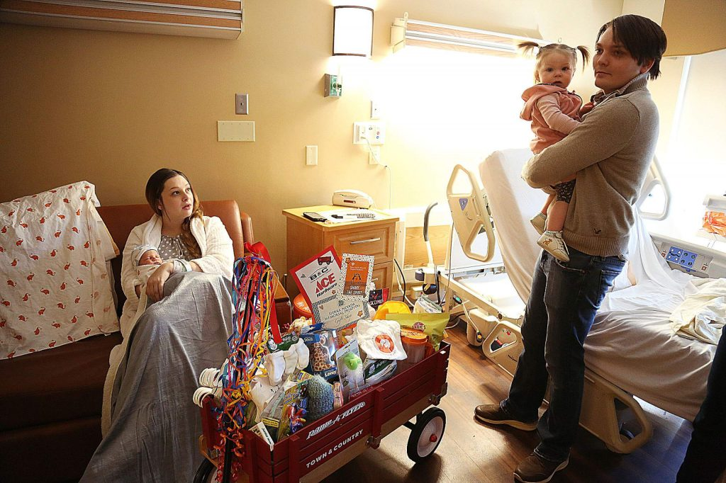 First baby parents Haley and Colin Wright hold their two children Friday in the hospital room where newborn Colin Carter Wright was born. This is also the same room where Haley and the couple's first child was born.