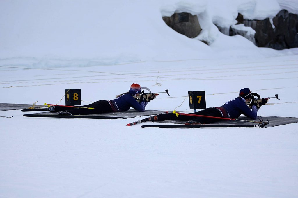 Kim Harris, left, and Jen Lang-Ree zero their rifles during morning practice at Auburn Ski Club.