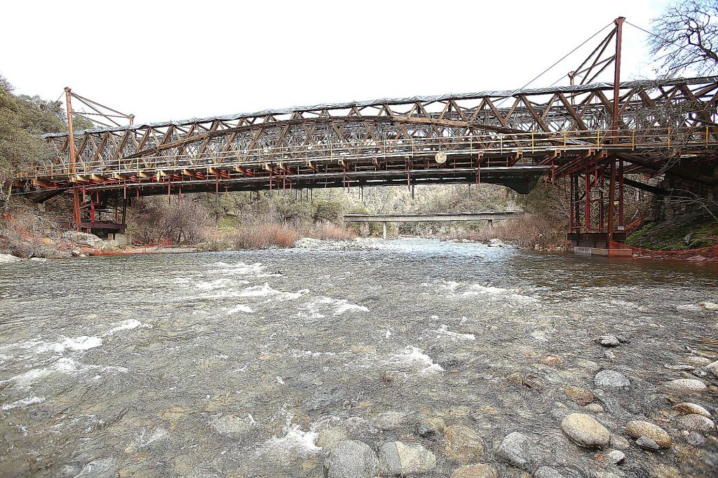 The Bridgeport Bridge sits uncovered in Tuesday's light rain. The completion of the bridge's restoration has been pushed back.