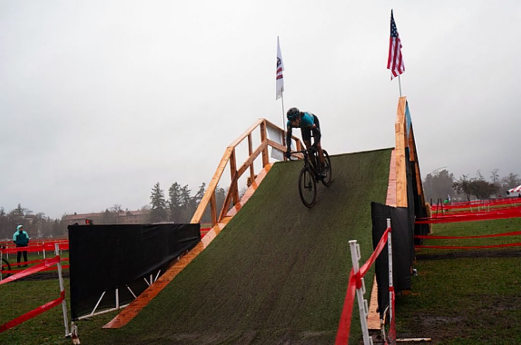 "Jonathan Baker descending one of the two ""Fly-overs"" in driving rain at the National Cyclocross race at Fort Steilacoom Park in Lakewood, Washington."