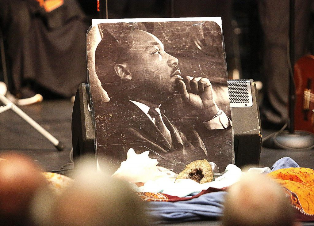An image of Dr. Martin Luther King Jr.sits at the foot of the stage during Monday's free gospel concert, reminding attendees why the day's celebrations are in order.