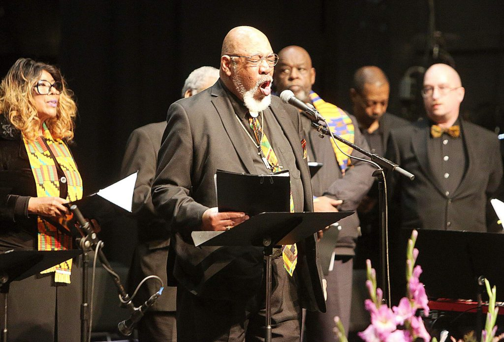 """Ennis Herrield sings the deep notes of the song """"Deep River"""" on Monday from the stage of the Nevada Theatre during the 38th annual King Day free gospel concert."""