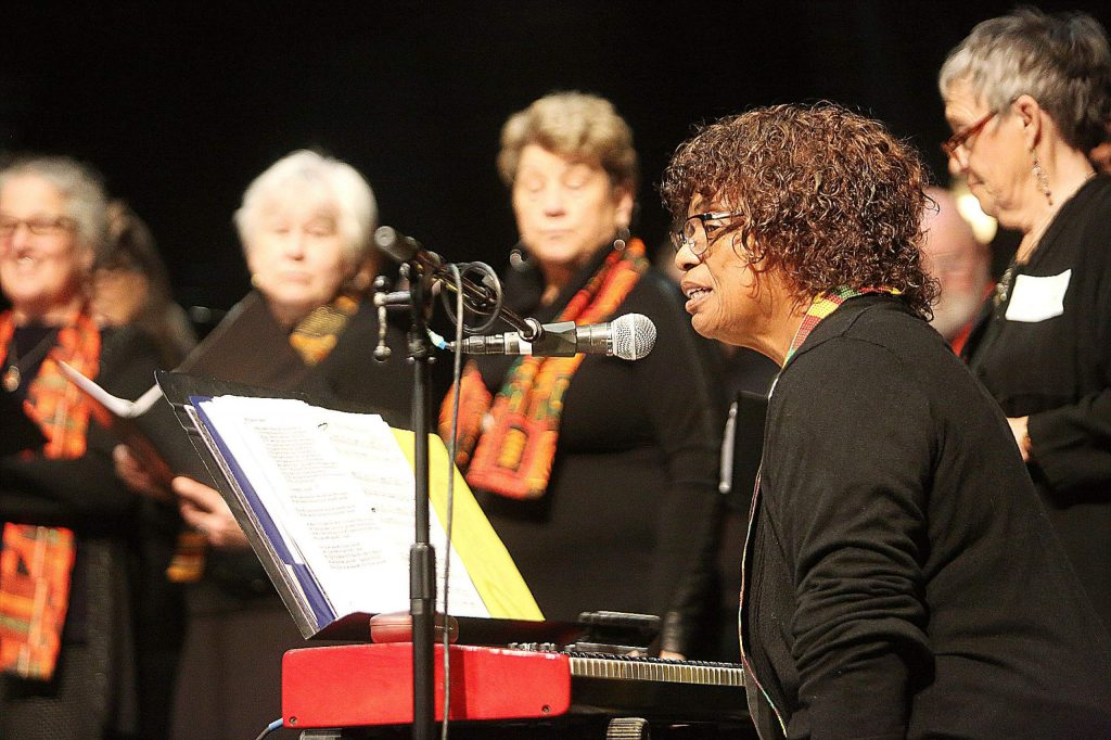 Organist Zenobia Brokenbrough addresses the audience before leading the gospel choirs through a song Monday at the Nevada Theatre.
