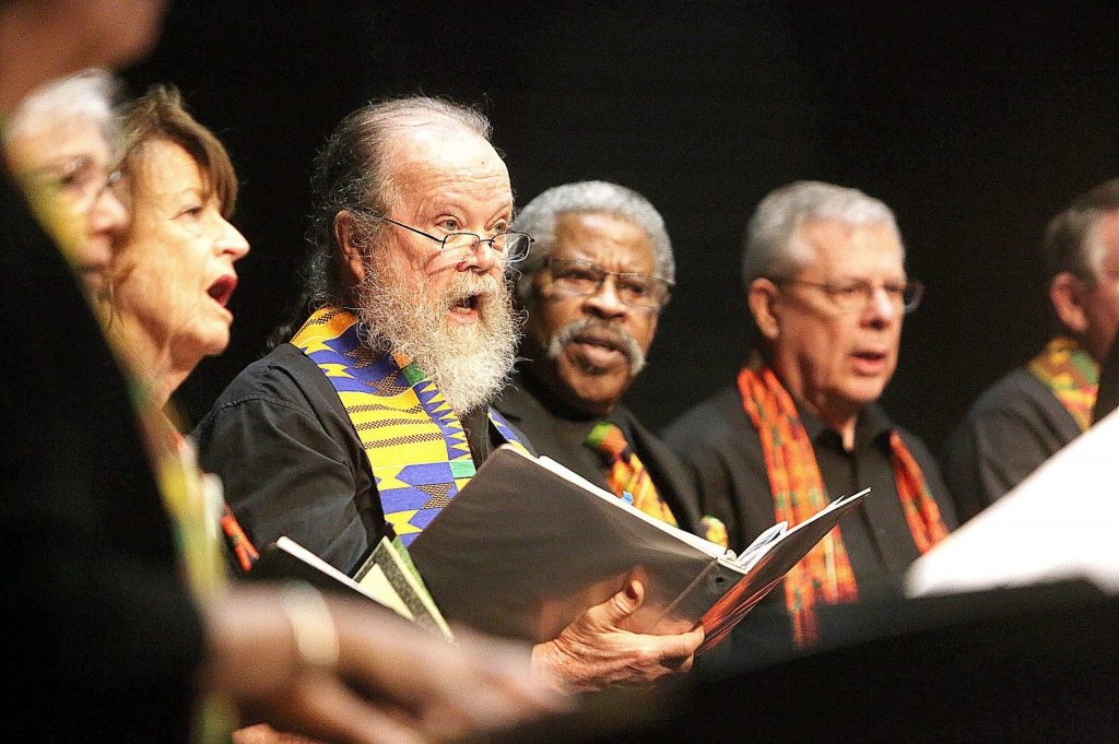 Gospel choir members sang songs that fit with the concert's themes: Unity, Remembering the Journey and Stand Up Together.