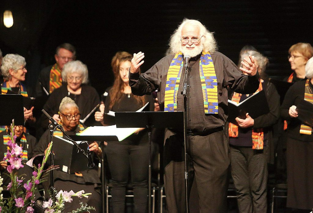 Choir conductor Stan Thomas Rose addresses the audience before performances.