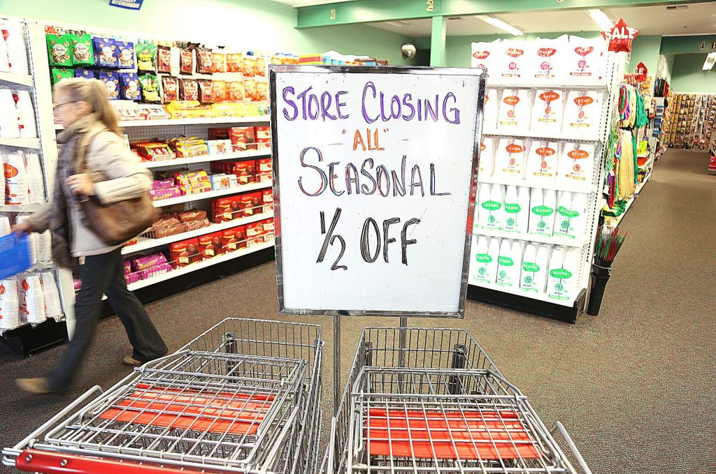 Shoppers make their way through the aisles of The Dollar Deluxe Store at 1125 Sutton Way. The store, along with neighboring Big 1 Appliance, will close March 1.