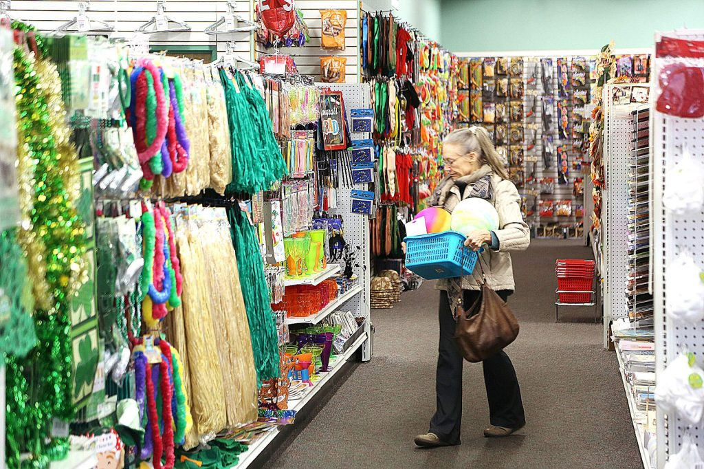 A Dollar Deluxe Store shopper picks her selections from the shelves earlier this week. The store, a favorite among crafters, has announced that it will be closing soon.