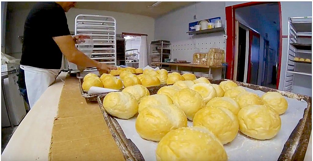 An employee of Dupre's Baking Company preparing bread. The shop's co-owners have moved all the baking equipment out of the shop.