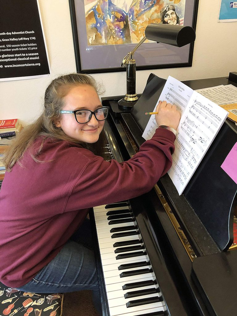 Lydia Fuller-Hall puts the finishing touches on her newest composition, ready to be unveiled during Sunday's concert, Poetry in Song, presented by InConcert Sierra.