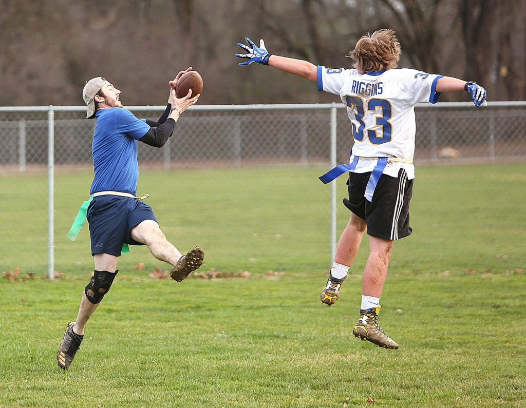 Tecmo's Connor Phillips catches a pass over Team Brooke's Connor Johnson.