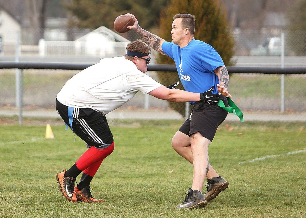 Team Brook's Quinn Anderson goes after Tecmo quarterback Matt Reiswig's flags during Saturday's championship game.