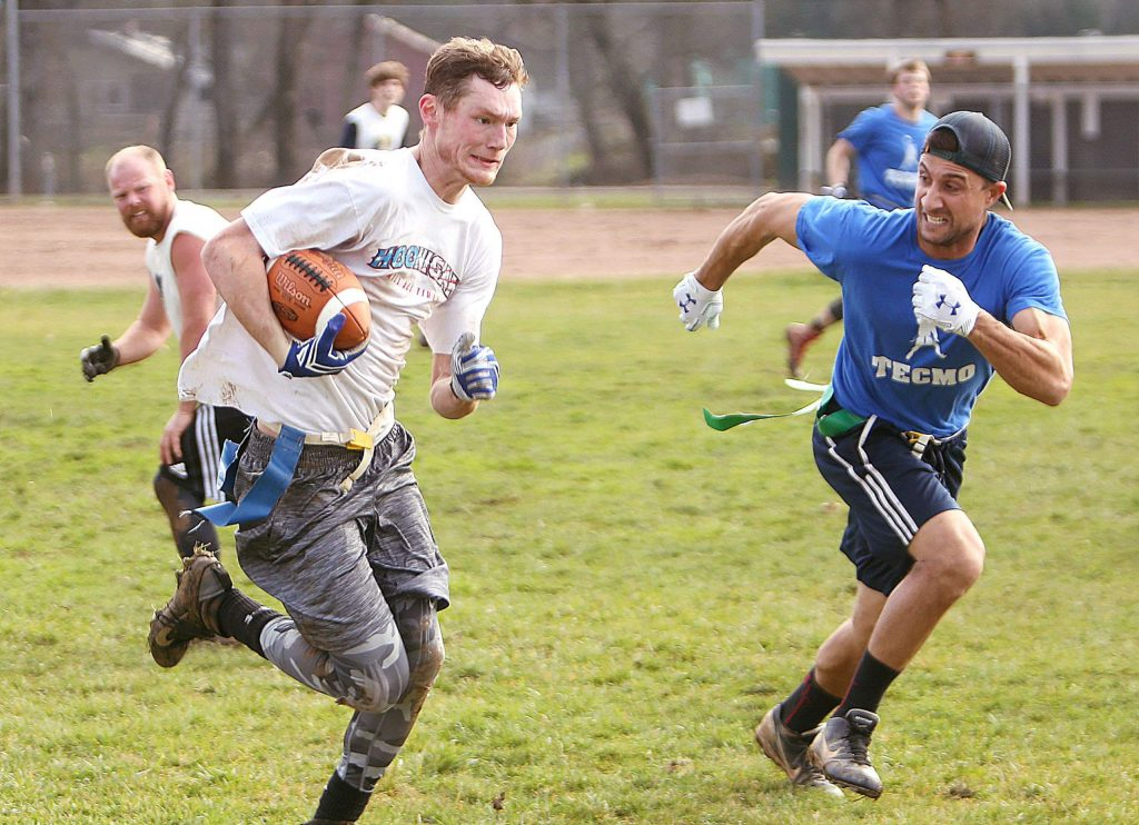 Team Brooke's Ben Brooke tries to avoid Tecmo's Steve Lime during Saturday's Nevada County Adult Sports Association's Flag Football championship game held at Western Gateway Park. Tecmo took away the win after all was said and done giving them three straight championships.