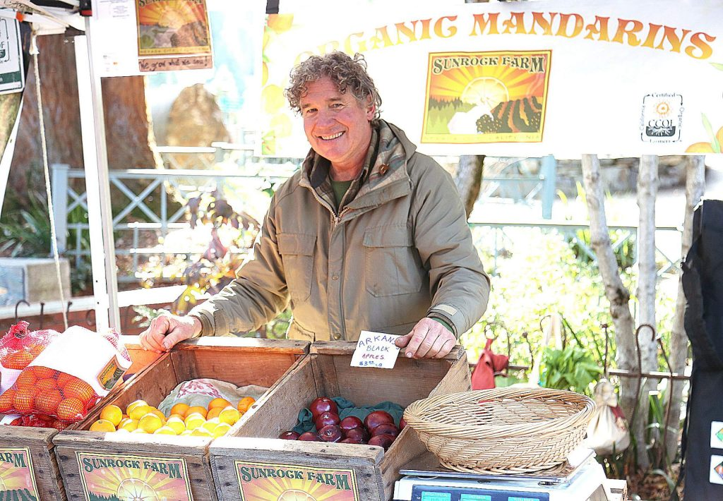 Jeff Wells of Nevada City's Sunrock Farms smiles after selling some of his citrus products to those at the first Nevada City Farmer's Market of the year Saturday in the Three Forks Parking lot. The farmer's market will continue at the same location every first Saturday morning of the month until May, when the market will return to every Saturday.