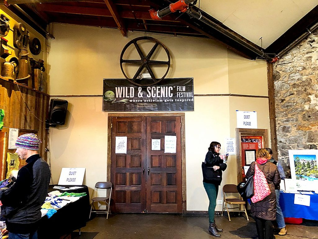 Wild & Scenic Film Festival-goers mingle at the Miners Foundry, where a film is being shown. The four-day festival kicked off Thursday and ends today.