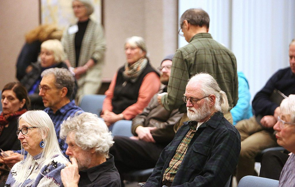 Members of the audience listen to the responses of the District 1 congressional candidates during Thursday's League of Women Voters forum. Members of the audience were able to have their questions answered as well.