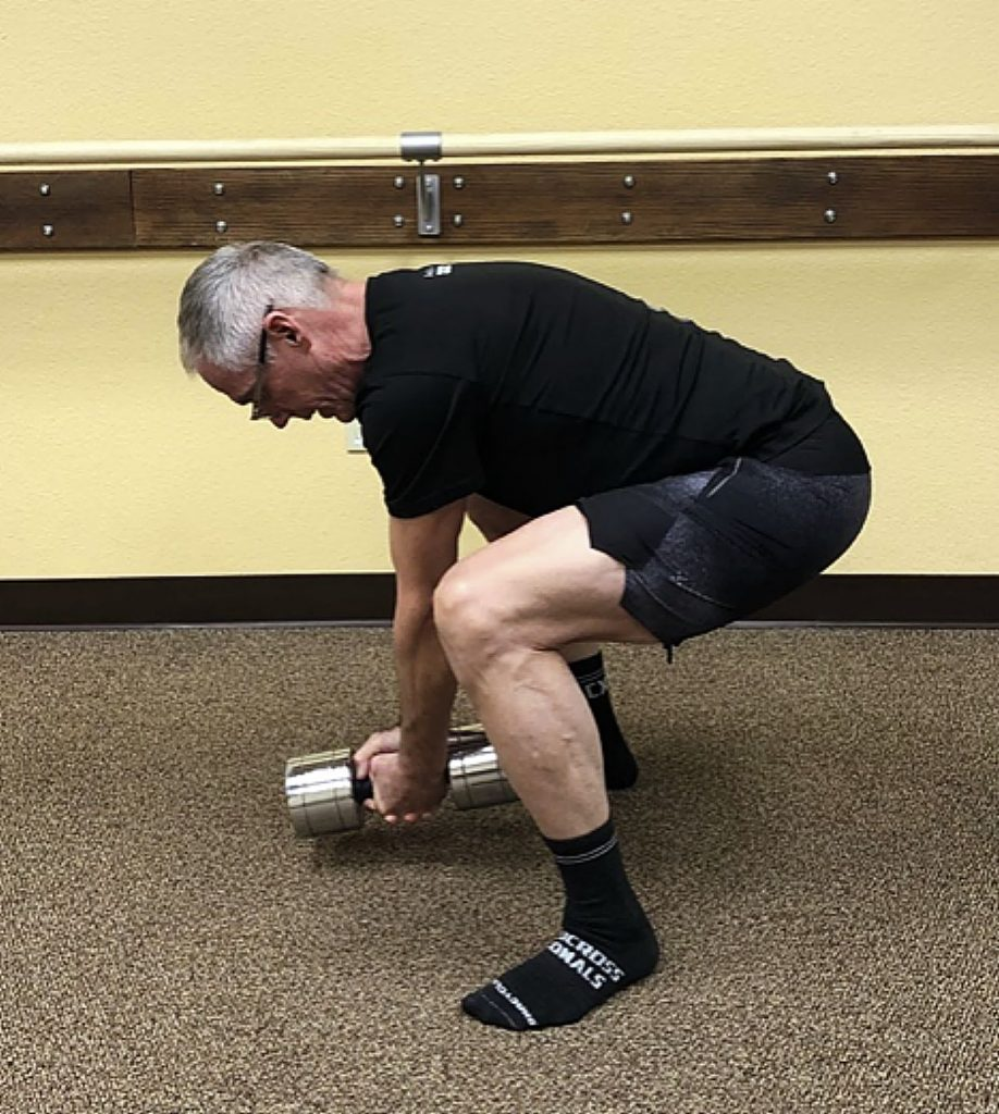 Lifting heavy objects with a flexed or rounded back is the preferred method. This allows for the load to be distributed throughout the entire body. Here in this picture one can see that the load is distributed across the ankles, knees, hips, entire spine and then the arms. The power of the lift occurs primarily from the gluteal and leg muscles with the back muscles and its connective tissue creating great tension for support.