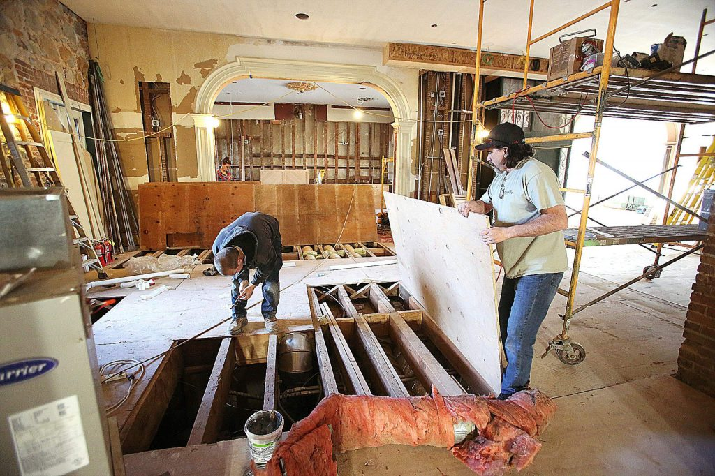 Sierra Foothills Construction superintendent Ken Porter, right, helps address some ducting issues with workers Tuesday afternoon at the historic Holbrooke Hotel currently under renovation in downtown Grass Valley. Renovating the 160-year-old building has held its challenges and workers hope to re-open the hotel by mid-2020.