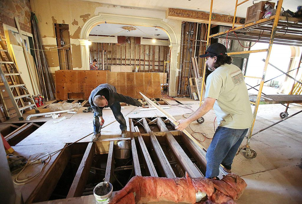 Sierra Foothills Construction superintendent Ken Porter, right, helps address some ducting issues with workers Tuesday afternoon at the historic Holbrooke Hotel currently under renovation in downtown Grass Valley. Renovating the 160-year-old building has held its challenges and workers hope to reopen the hotel by mid-2020.