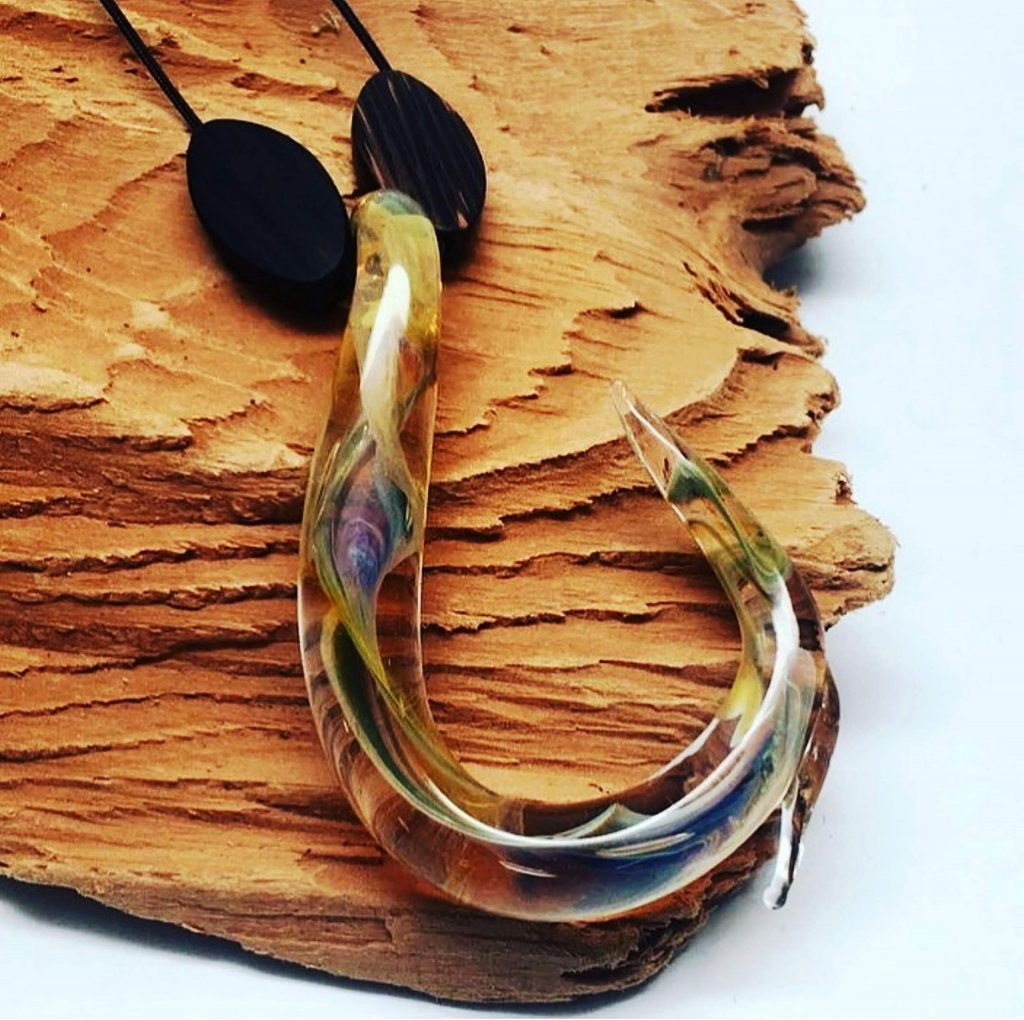 Glass-blowing Artist Gabe White created and now sells fish hook necklaces for $38, with a percentage donated to restoration of fire-ravaged Australian wildlife habitats.