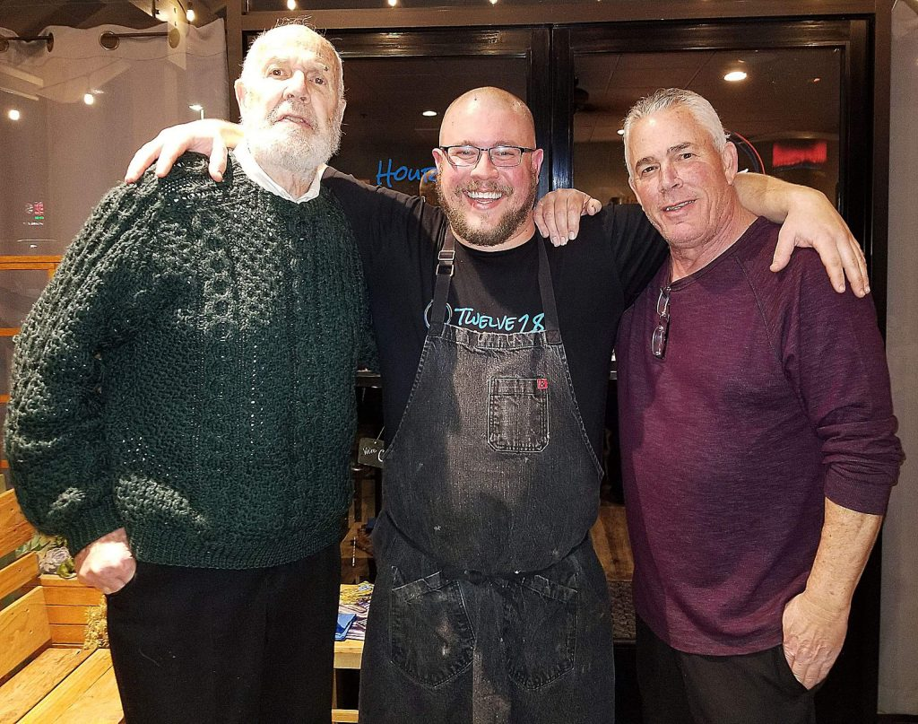 "Three generations teamed up to present a birthday and third anniversary edible extravaganza at Twelve 28 in Penn Valley. Pictured are chef Zach Sterner, center, grandfather Peter ""Moose"" Sterner, left, and father Michael Sterner."