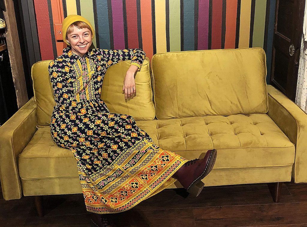 Leslie Dilloway, owner of Tiger Alley in Nevada City, kicks back on her vintage couch inside the store.