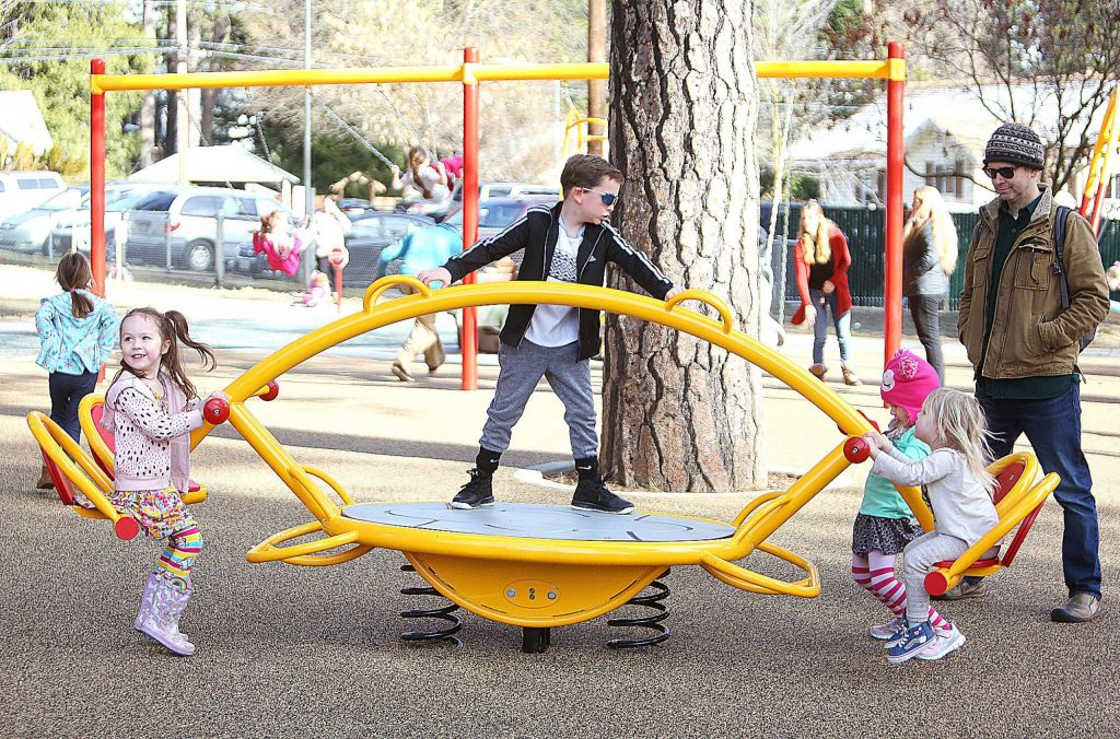 A four seated teeter-totter is just one of the many fun park elements for children to explore and use at the new Minnie Park in Grass Valley.