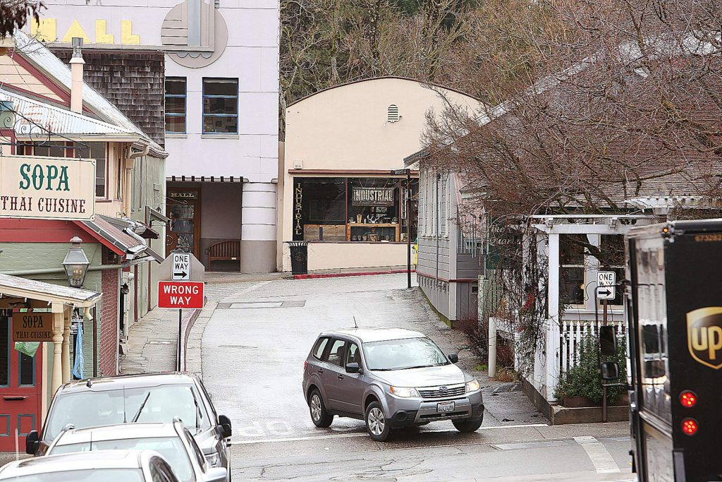 A motorist drives off of the one-way York Street in Nevada City and onto the one-way Commercial Street.