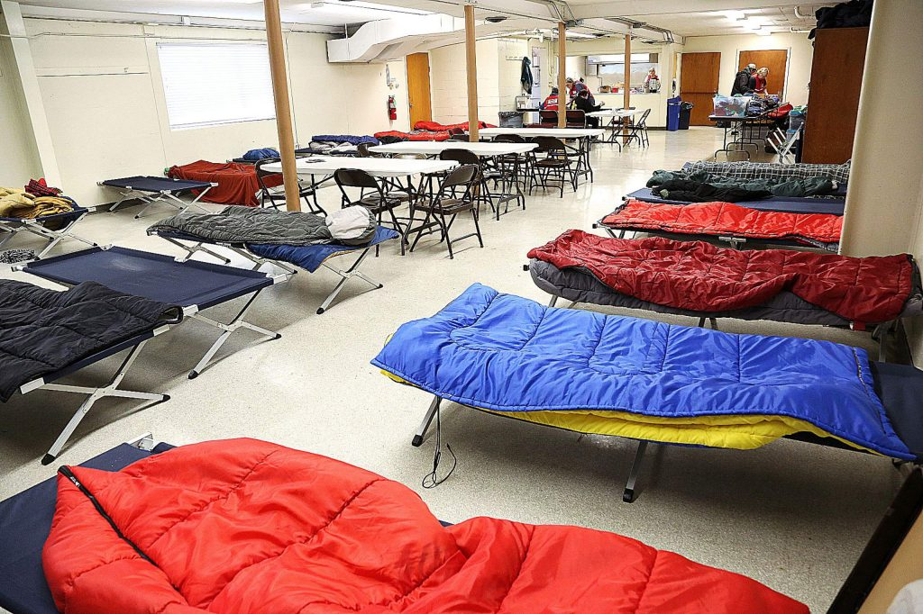 Cots with sleeping bags sit ready for people at the Nevada City Veterans Hall where Sierra Roots had its cold weather shelter in place for the point-in-time homeless count.
