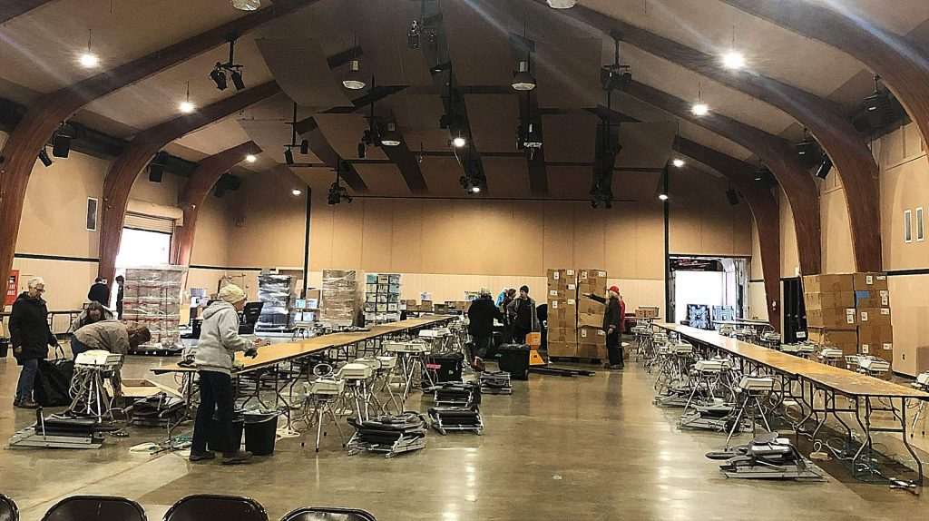 Volunteers setting up the free health clinic at the Nevada County Fairgrounds Thursday, Jan.9.
